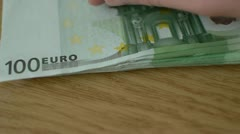 Hand Lays Down On The Table A Pack Of Euro Banknotes Stock Footage