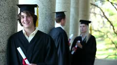 Portrait of a male graduate - stock footage