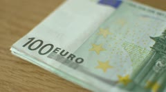 Re-counting a bundle of 100 Euro banknotes Stock Footage