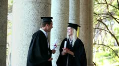 Male graduate comes and gives high-five Stock Footage