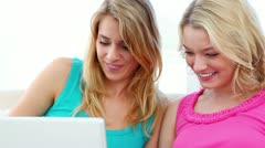 Happy women using a laptop Stock Footage
