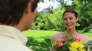 Happy brunette woman holding a bunch of flowers Stock Footage