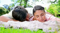 Peaceful couple napping on a blanket Stock Footage