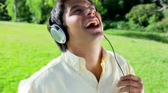 Happy man listening to music while singing Stock Footage