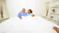 Ethnic Couple Granddaughters Relaxing Bed Stock Footage