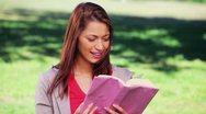 Happy woman reading an interesting novel Stock Footage