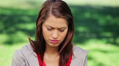 Upset brunette woman standing upright Stock Footage