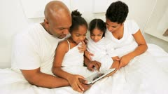 African American Children Parents Playing Bed Wireless Technology Stock Footage