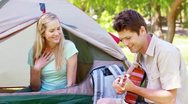Man singing a song to his girlfriend Stock Footage