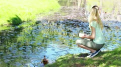 Woman nourishing a duck Stock Footage
