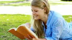 Woman reading a novel Stock Footage
