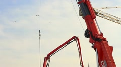 Telescopic hydraulic mobile crane at the construction site Stock Footage