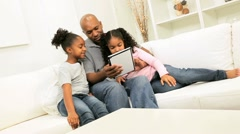 Ethnic Father Daughters Wireless Tablet Home Stock Footage