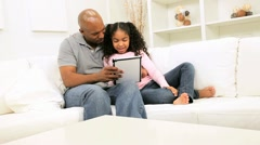 Ethnic Father Daughter Home Touch Screen Tablet - stock footage