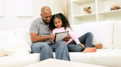 African American Father Daughter Home Wireless Tablet Stock Footage