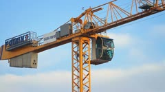 Hoisting tower crane arm turns around Stock Footage