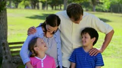Smiling family standing upright together Stock Footage