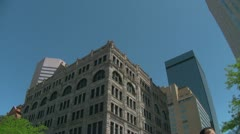 16th Street Mall Pan Down from building to shoppers and bus Stock Footage