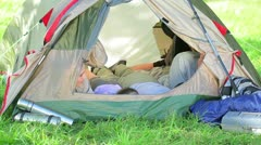 Smiling family lying in a tent Stock Footage