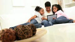 Lone Ethnic Parent Child Wireless Home Technology Stock Footage