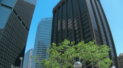 16th Street Mall Pan down from skyskrapers wide angle lens Stock Footage