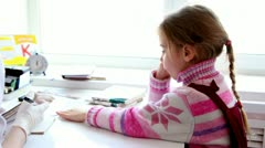 Little girl sit at doctors table in front of window Stock Footage