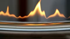 Tongues of flame at edge of metal plate Stock Footage