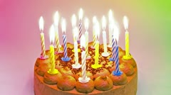 18 Candles burn down on Birthdaycake Stock Footage