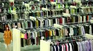 Stock Video Footage of Mannequin and lot of clothes in large shop