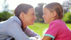 Mother and daughter rubbing their noses Stock Footage