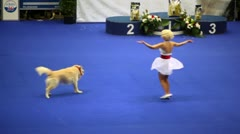 Woman dance with her dog of atlas shepherd breed at International Dog Show Stock Footage