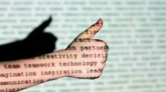 Motion text projection on childs hand with fist and thumb up Stock Footage