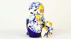 Four russian nesting dolls stand grouped and spin Stock Footage