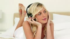 Blonde haired woman listening to music Stock Footage