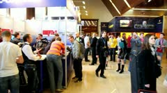 People walk around exhibition hall during Game Developers Conference 2011 Stock Footage