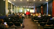Lot of people sit in conference hall during Game Developers Conference 2011 Stock Footage