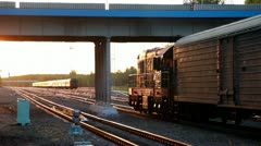 Train ride under bridge with car passes by Stock Footage