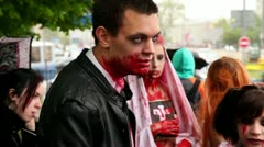 Bloody zombies youth closeup at background of city during Zombie Parade Stock Footage
