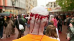 Zombie Parade by stree with bloody head after trepanation of skull Stock Footage