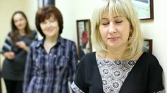Woman working in beauty salon affably looks and smiles Stock Footage