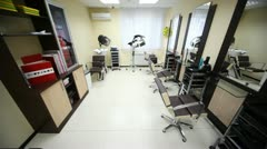 In salon hairdressing salon there are three workplaces, dryer and washbasin Stock Footage