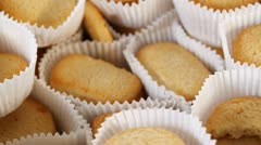 Cakes in paper gradually disappear from tray Stock Footage