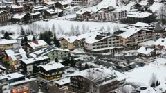 Roofs of houses stand covered with white snow Stock Footage