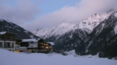 Chalets stand on slope of mountain against mountains Stock Footage