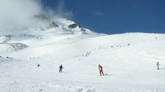 Skiers turn on slope of mountain Tiefenbachkogl Stock Footage