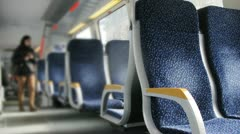 Dark blue chairs with yellow armrests stand in carriage of train Stock Footage