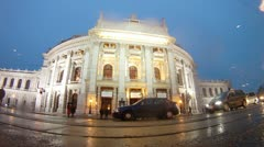 Cars go near to Burgtheater in rain Stock Footage