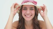 Happy brunette woman holding her hat Stock Footage