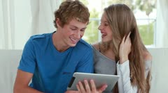 Couple looking at an ebook together Stock Footage