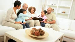 Happy ethnic family social time photo album Stock Footage